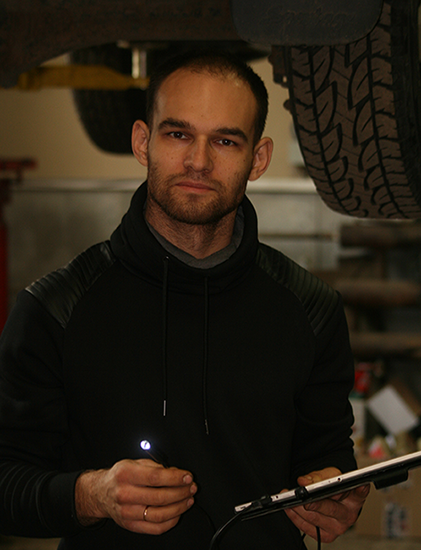 This is Denis with an endoscope in a car service.