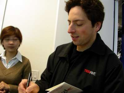 Sergey Brin signs the book The Google Story