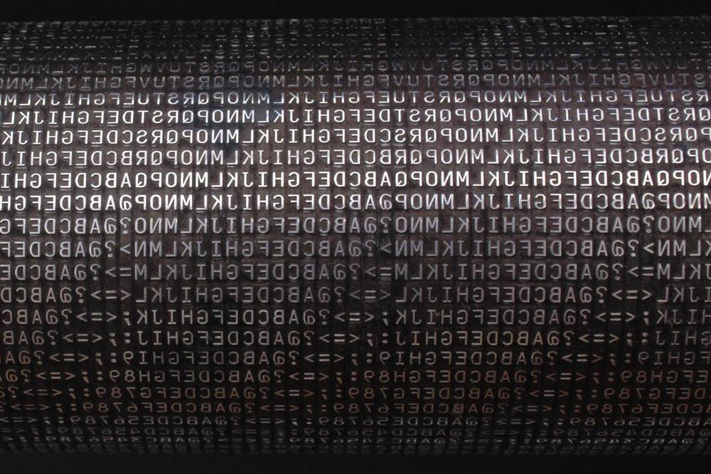 Как принтер IBM 1403 печатал в 1963 году 1100 строк в минуту? Секрет в электромагнитных молоточках
