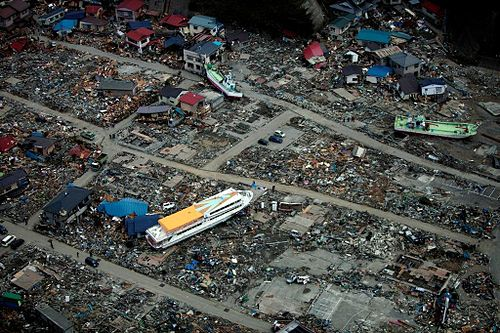 US Navy 110320-M-0145H-063 A large ferry boat rests inland amidst destroyed houses after a 9.0 earthquake and subsequent tsunami struck Japan March