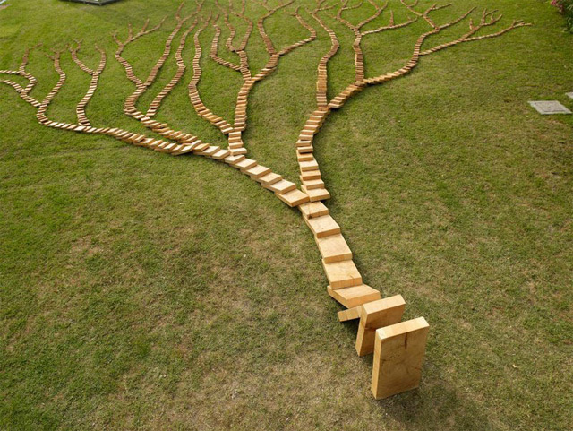 http://www.thisiscolossal.com/2013/01/a-wooden-domino-tree-by-qiu-zhijie/