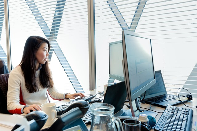 Image of women on her desktop in the workplace