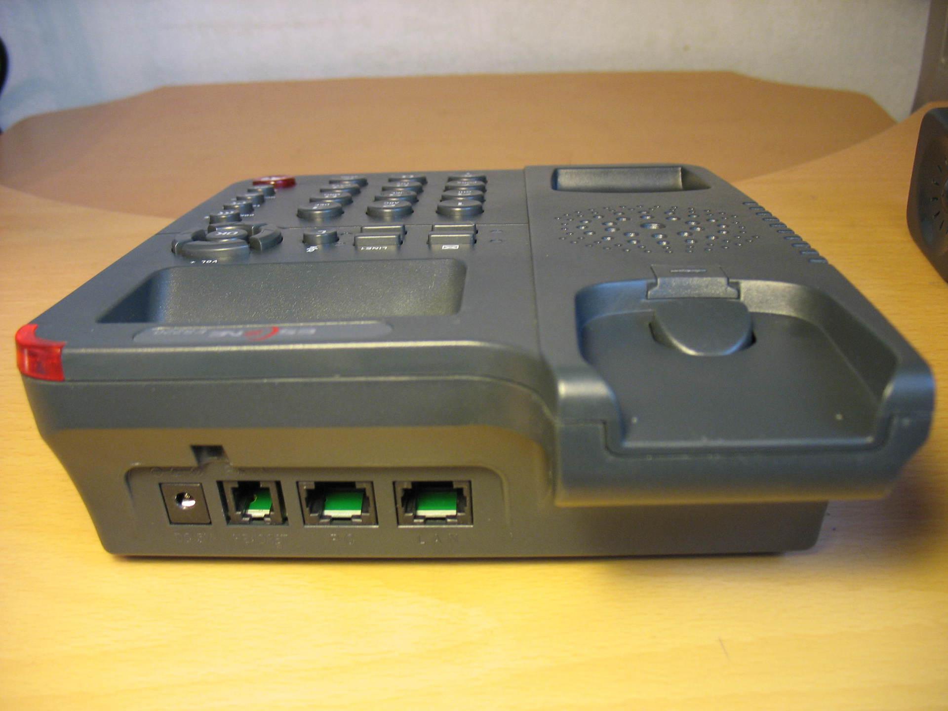 Сетевые интерфейсы и разъем для гарнитуры телефона Escene ES220